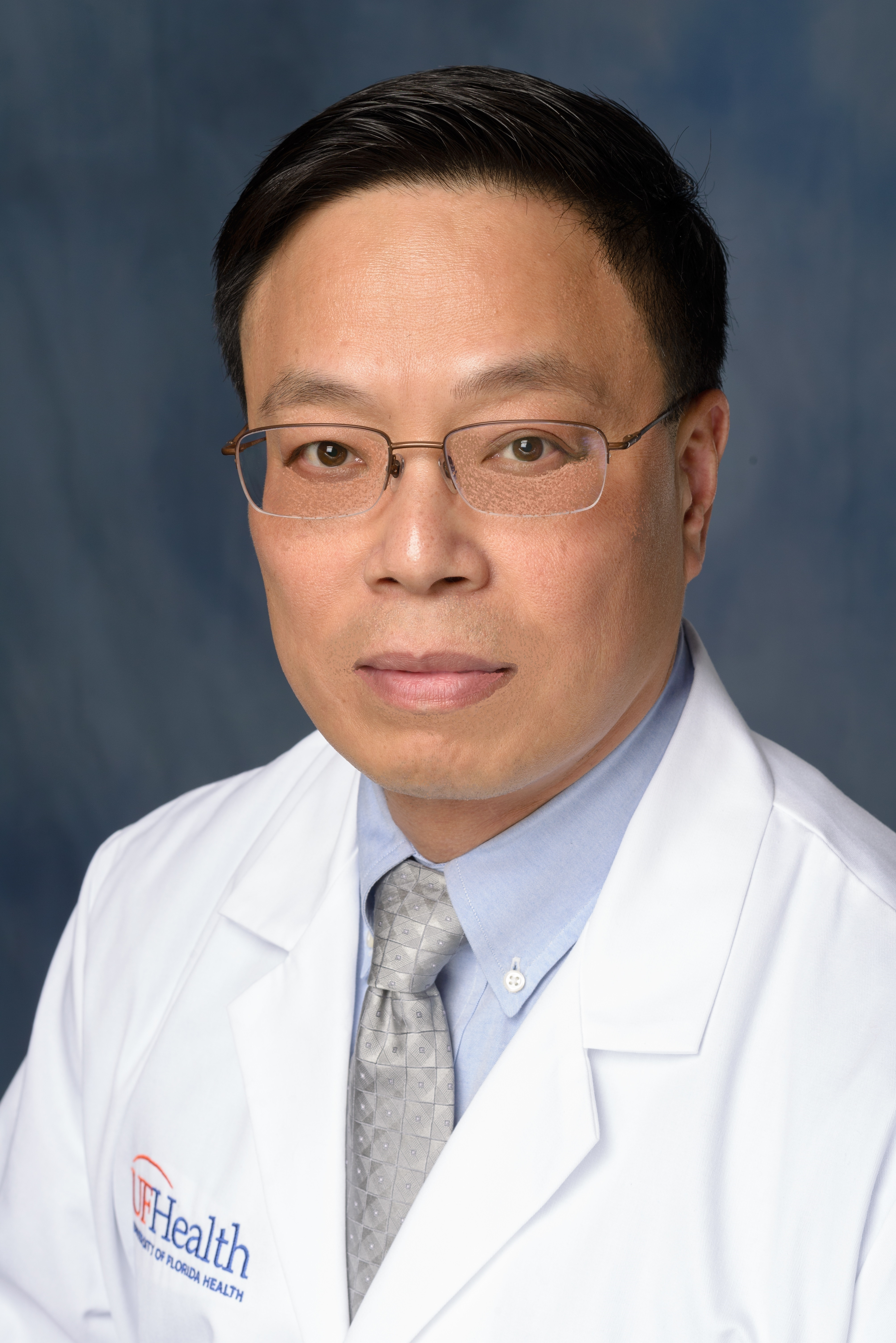 XU ZENG, M.D., Ph.D.
